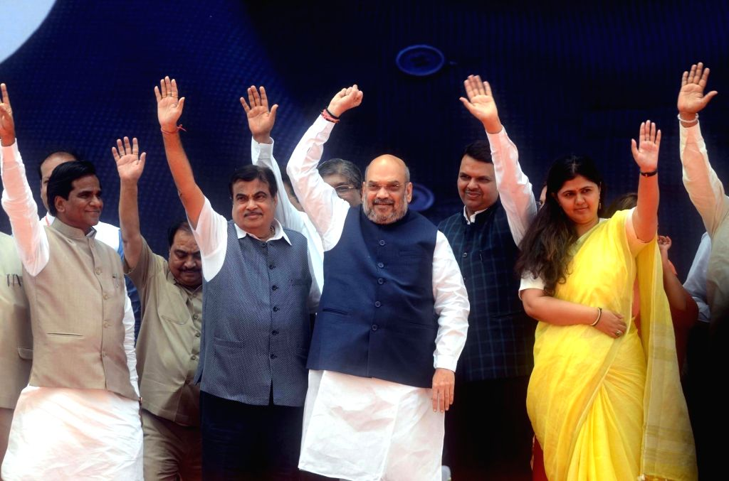 BJP chief Amit Shah, Union Minister of Road Transport and Highways Nitin Gadkari, Maharashtra Chief Minister Devendra Fadnavis, Women and Child Welfare Minister Pankaja Munde and state ... - Devendra Fadnavis, Amit Shah and Raosaheb Danve-Patil