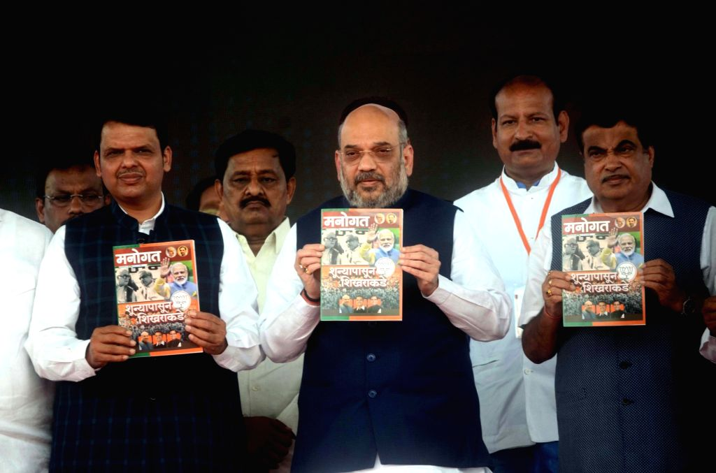 BJP chief Amit Shah, Union Minister of Road Transport and Highways Nitin Gadkari and Maharashtra Chief Minister Devendra Fadnavis during a rally organised to celebrate BJP's 38th Foundation ... - Devendra Fadnavis and Amit Shah