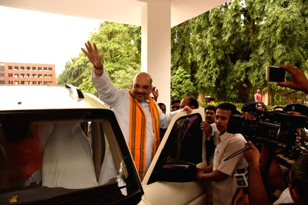 BJP chief Amit Shah waves at his supporters in Bhubaneswar, on July 4, 2017. - Amit Shah