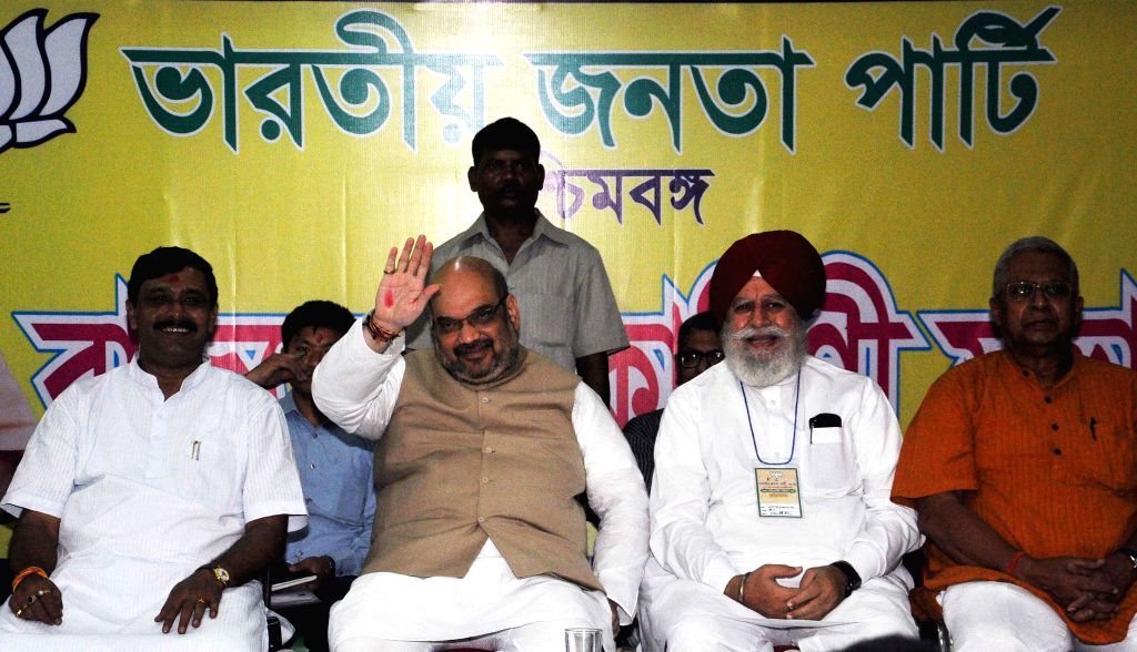 BJP chief Amit Shah, West Bengal BJP president Rahul Sinha, BJP MP from Darjeeling SS Ahluwalia and Tathagata Roy a party meeting in Kolkata on Sept 7, 2014. - Amit Shah, Rahul Sinha and Tathagata Roy