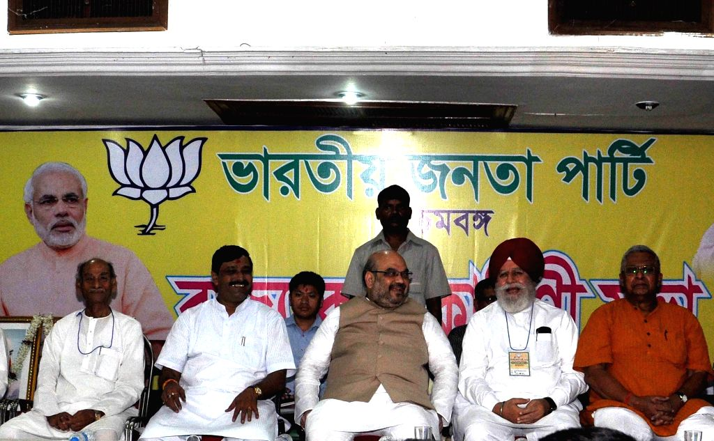 BJP chief Amit Shah, West Bengal BJP president Rahul Sinha and BJP MP from Darjeeling SS Ahluwalia, Tathagata Roy and others during a party meeting in Kolkata on Sept 7, 2014. - Amit Shah, Rahul Sinha and Tathagata Roy