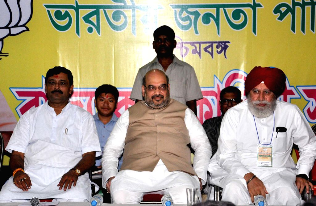 BJP chief Amit Shah, West Bengal BJP president Rahul Sinha and BJP MP from Darjeeling SS Ahluwalia during a party meeting in Kolkata on Sept 7, 2014. - Amit Shah and Rahul Sinha