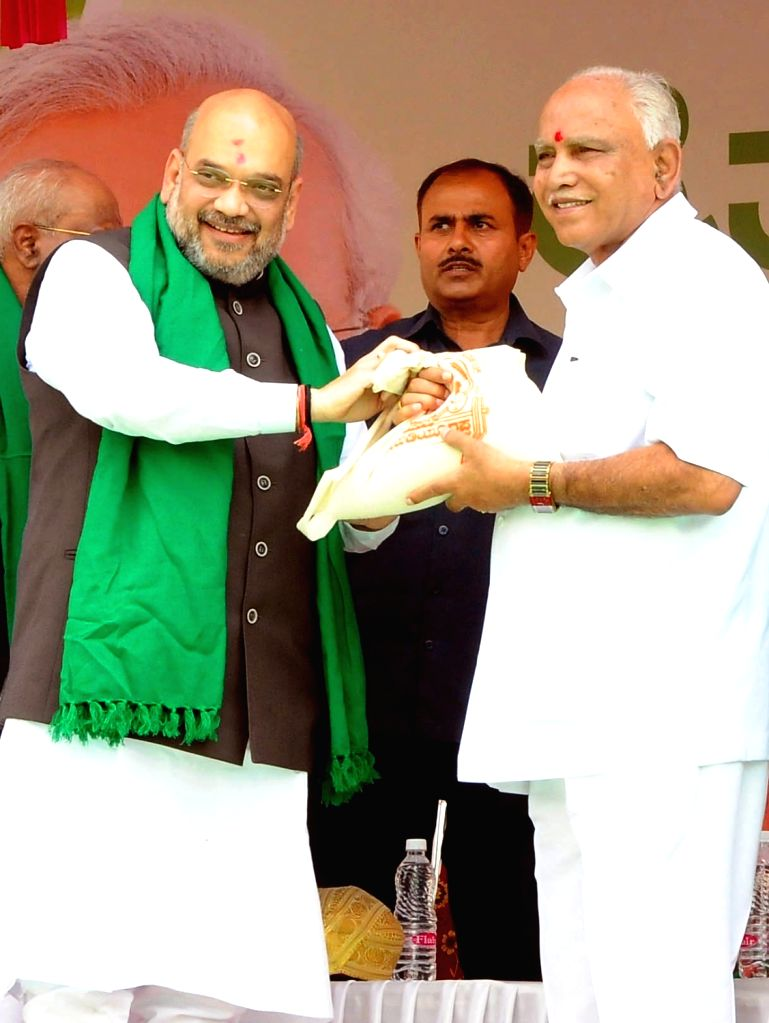 BJP chief Amit Shah with Karnataka BJP President B. S. Yeddyurappa during a BJP rally in Davanagere, on March 27, 2018. - Amit Shah