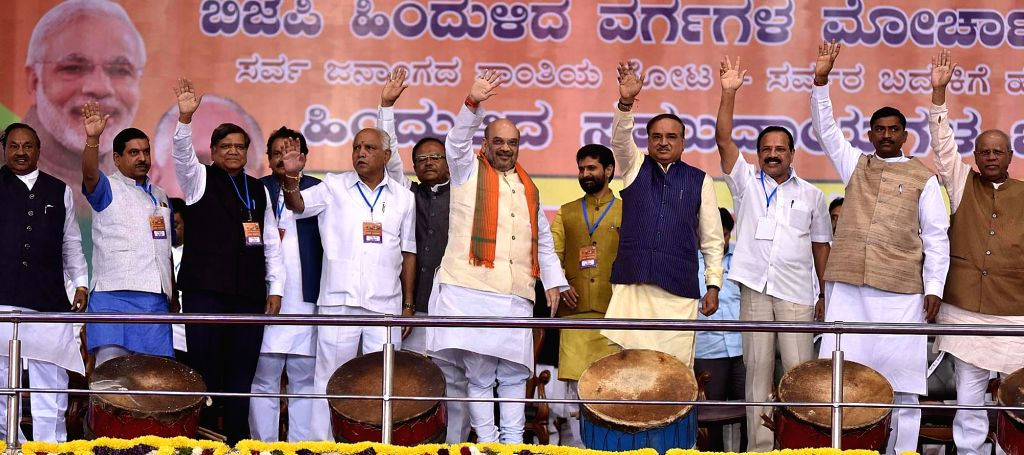 BJP chief Amit Shah with party leader BS Yeddyurappa during a party rally in Bengaluru, on Nov 27, 2016. - Amit Shah