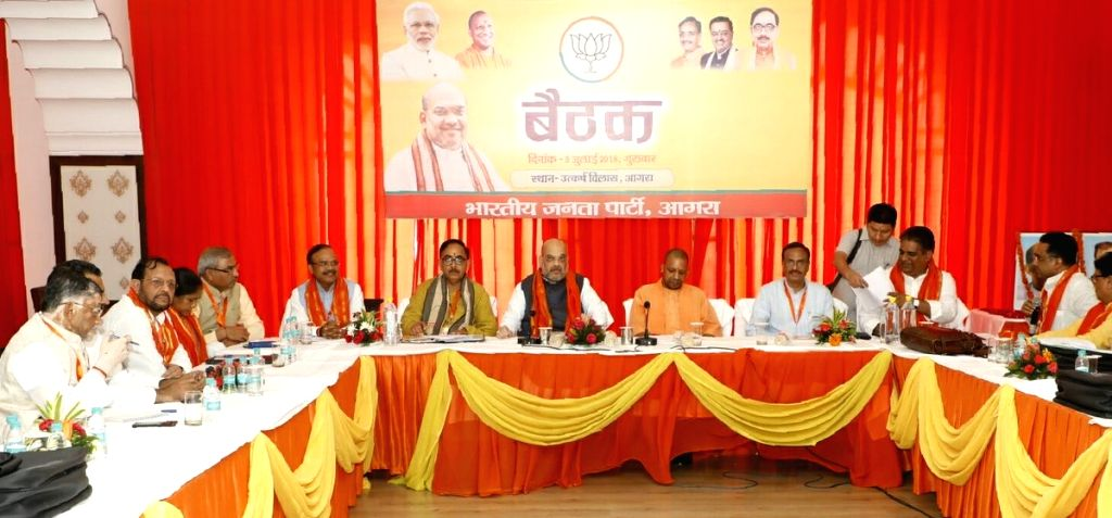 BJP Chief Amit Shah with party leaders - Uttar Pradesh Chief Minister Yogi Adityanath and Deputy Chief Ministers Dinesh Sharma and Keshav Prasad Maurya during a party meeting, in Agra on July ... - Yogi Adityanath, Dinesh Sharma, Keshav Prasad Maurya and Amit Shah