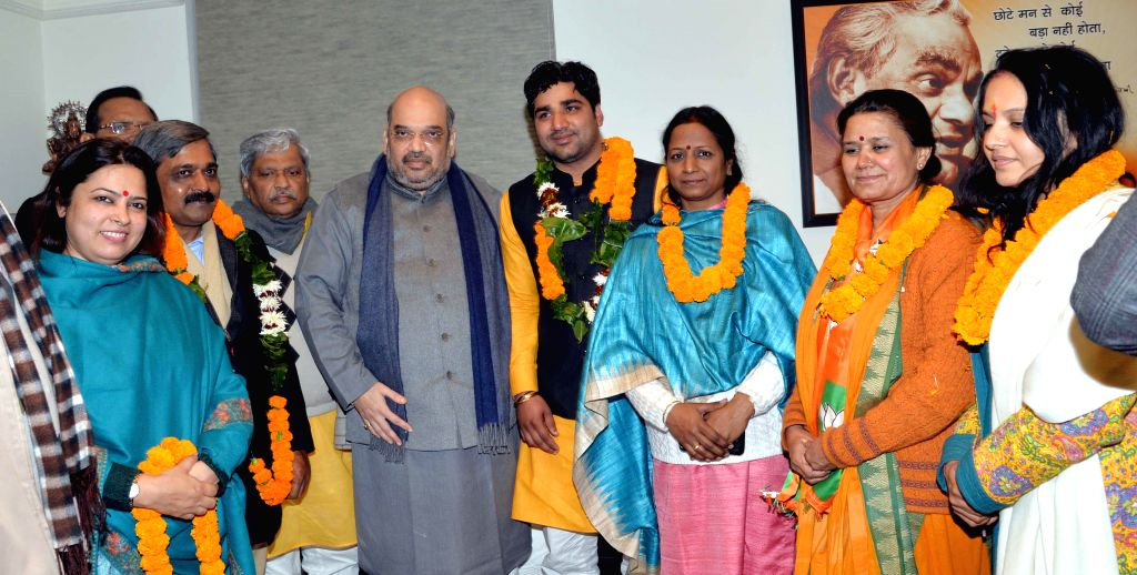 BJP chief Amit Shah with the BJP candidates who were declared victorious in the recent elections to the eight member Delhi Cantonment Board at BJP office in in New Delhi, on Jan 12, 2015.