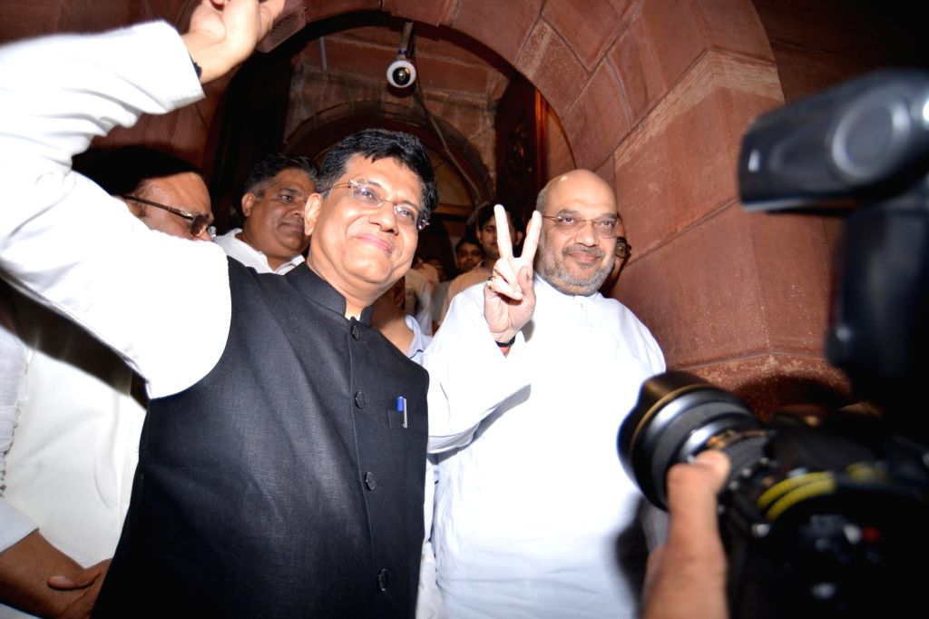 BJP chief Amit Shah with Union Minister Piyush Goyal come out of Parliament after no-confidence motion against Modi government was defeated on July 21, 2018. - Piyush Goyal and Amit Shah