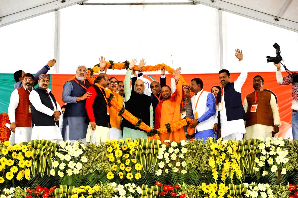 BJP chief Amit Shah with Uttar Pradesh Chief Minister and party leader Yogi Adityanath at a party meeting in Uttar Pradesh's Maharajganj district, on Feb 8, 2019. - Amit Shah