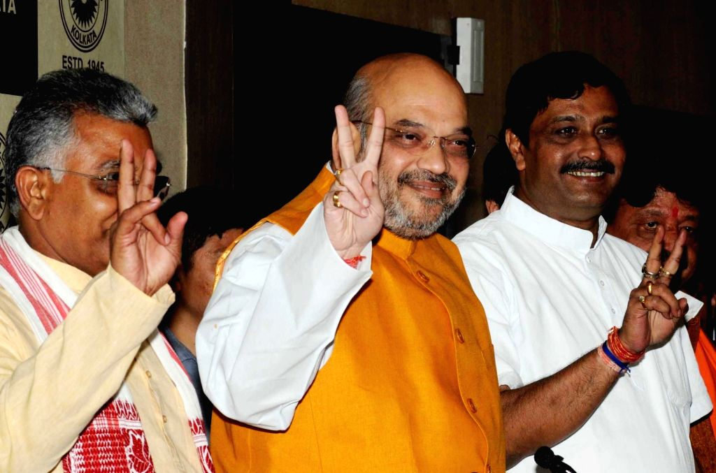 BJP chief Amit Shah with West Bengal BJP chief Dilip Gosh and party leader Rahul Sinha during a press conference in Kolkata on April 26, 2017. - Amit Shah and Rahul Sinha