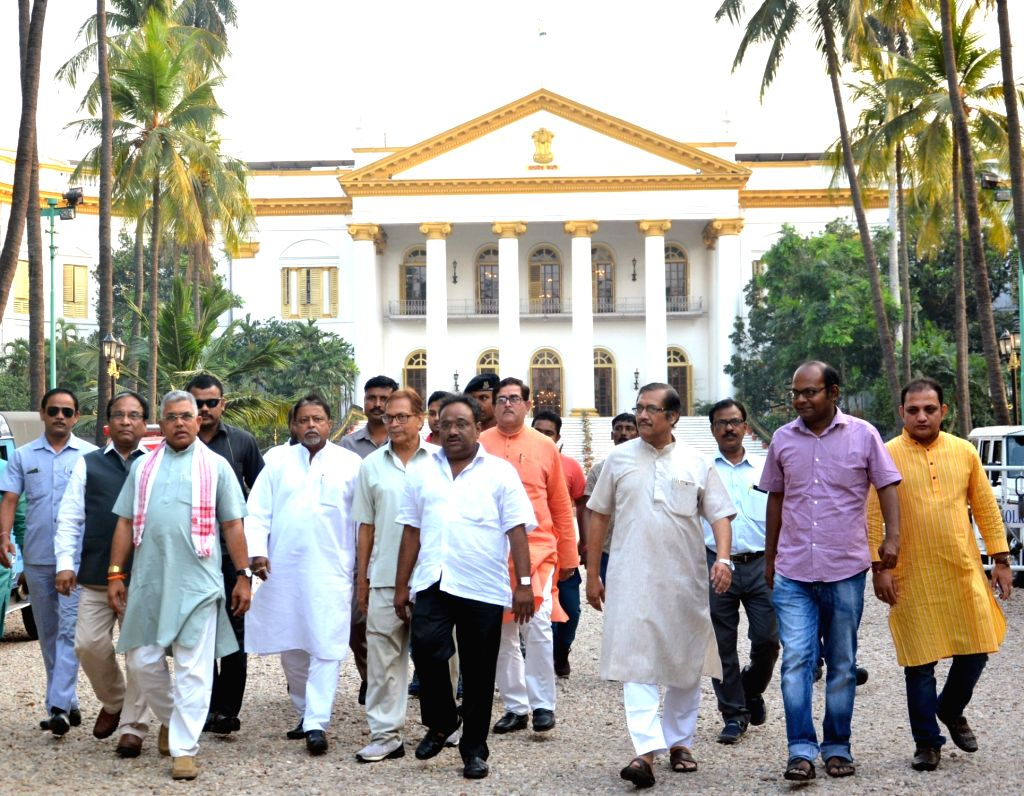 BJP delegation led by Dilip Ghosh, Mukul Roy and Jay Prakash Majumdar come out after meeting West Bengal Governor Keshari Nath Tripathi at Raj Bhawan in Kolkata on April 3, 2018. - Dilip Ghosh, Mukul Roy and Keshari Nath Tripathi