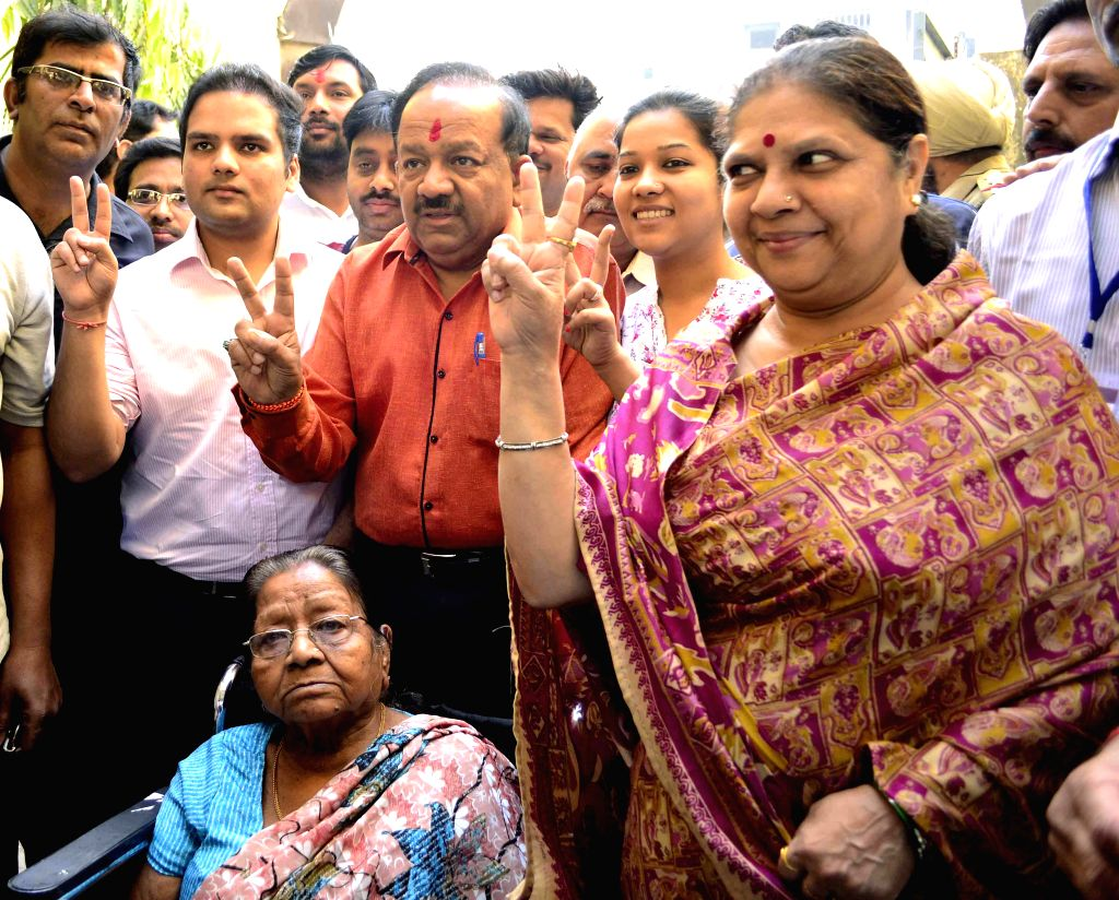 BJP Delhi unit president and candidate for 2014 Lok Sabha Election from Chandni Chowk, Harsh Vardhan arrives to cast his vote during the third phase of 2014 Lok Sabha Polls in New Delhi on April 10, .