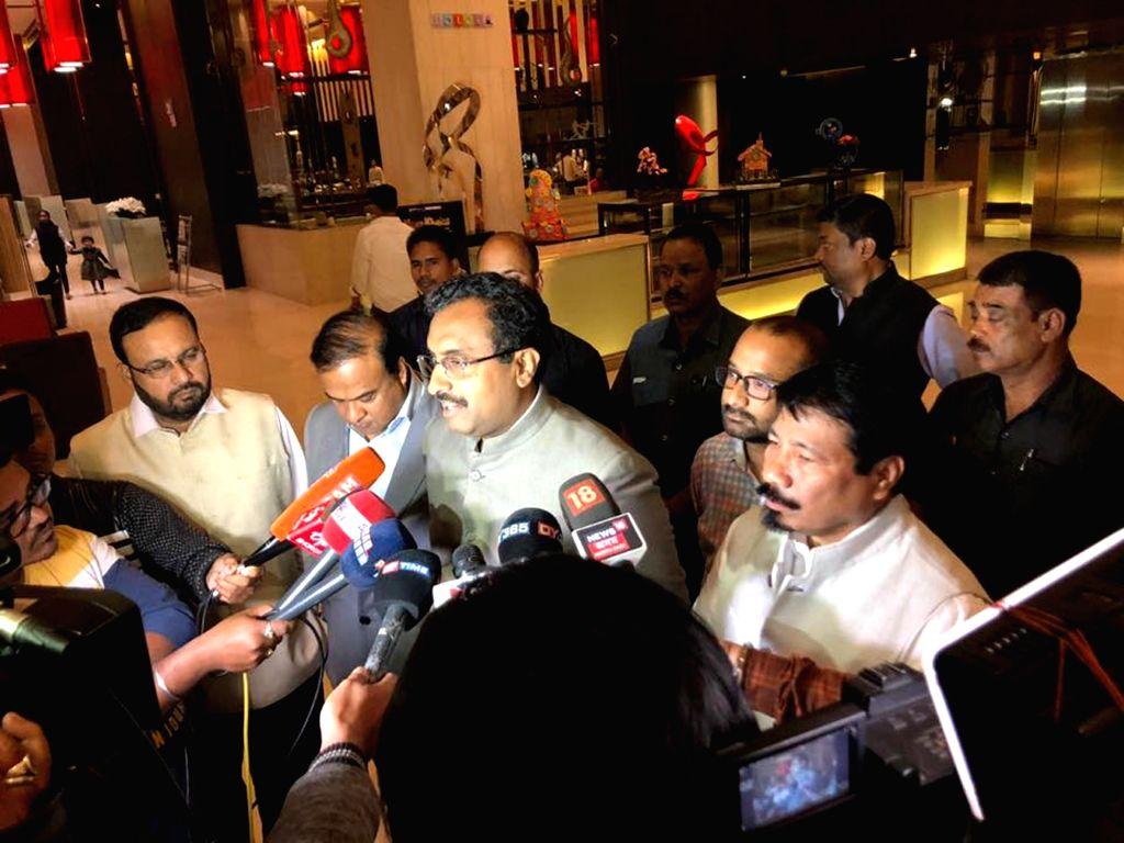 BJP General Secretary and Northeast incharge Ram Madhav along with Asom Gana Parishad (AGP) President Atul Bora, talks to media persons in Guwahati, on March 12, 2019. The Asom Gana ... - Keshav Mahanta