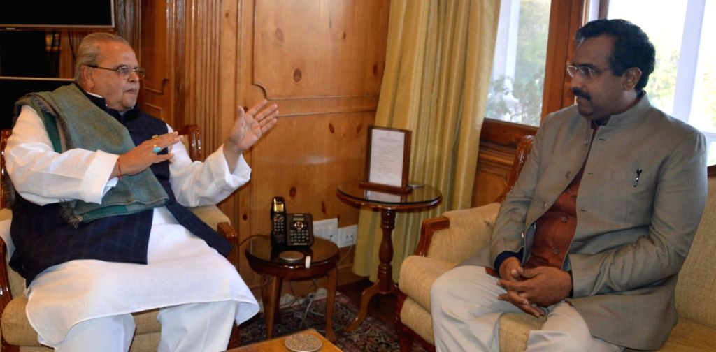 BJP General Secretary Ram Madhav calls on Jammu and Kashmir Governor Satya Pal Malik in Srinagar, on Oct 25, 2018. - Malik