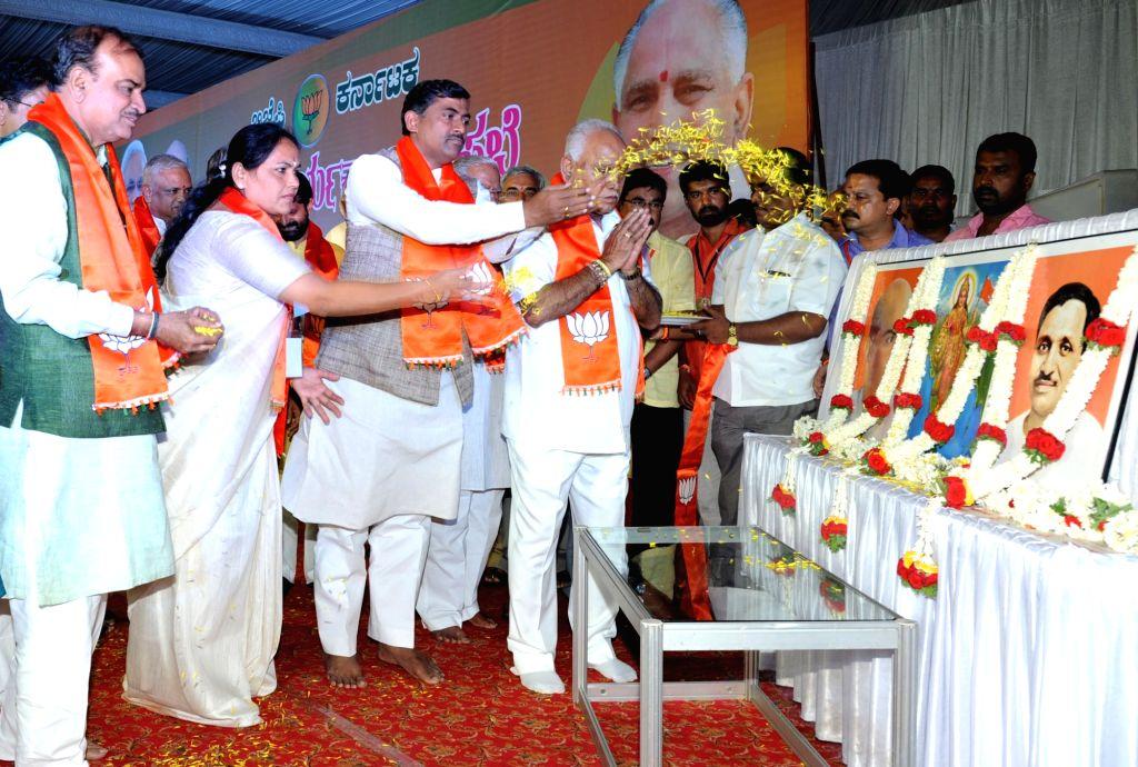 BJP Karnataka President BS Yeddyurappa, Union ministers Anant Kumar, Ramesh Jigajinagi with other dignitaries pays tribute to founder of the Bharatiya Jana Sangh Syama Prasad Mookerjee ... - Anant Kumar