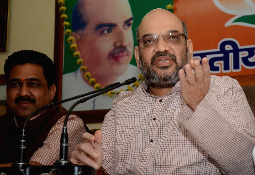 BJP leader Amit Shah addressing media in Lucknow on April 19, 2014.