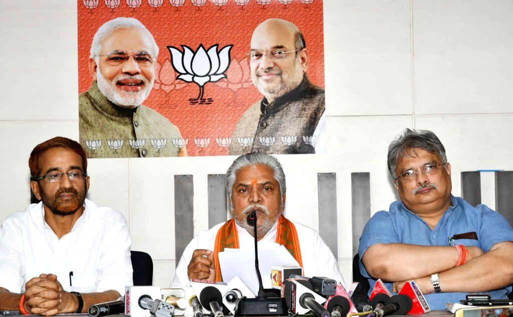 BJP leader and Bihar Agriculture Minister Prem Kumar addresses a press conference, in Patna on May 30, 2018. - Prem Kumar