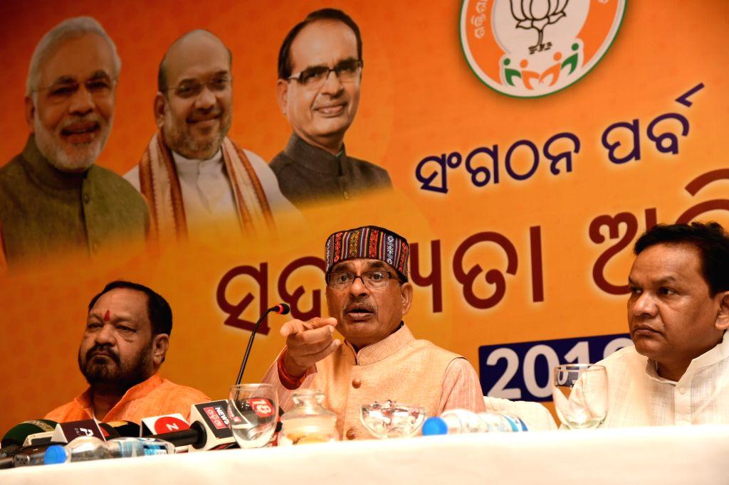 BJP leader and former Madhya Pradesh Chief Minister Shivraj Singh Chouhan addresses a press conference in Bhubaneswar on Aug 11, 2019. - Shivraj Singh Chouhan