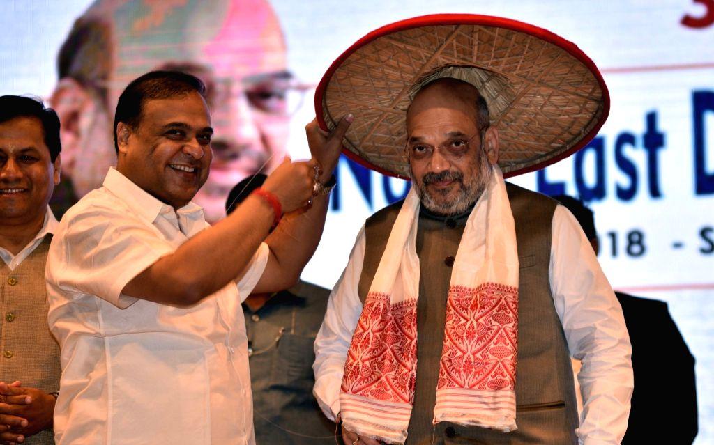 BJP leader and North East Democratic Alliance (NEDA) convener Himanta Biswa Sarma felicitates BJP chief Amit Shah with an Assamese Japi during the third Conclave of  North East Democratic ... - Amit Shah