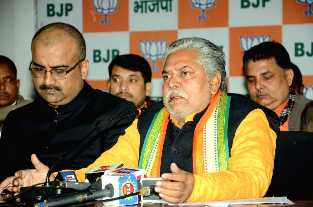 BJP leader and the leader of opposition in Bihar assembly Prem Kumar addresses a press conference in Patna on Jan 15, 2016.