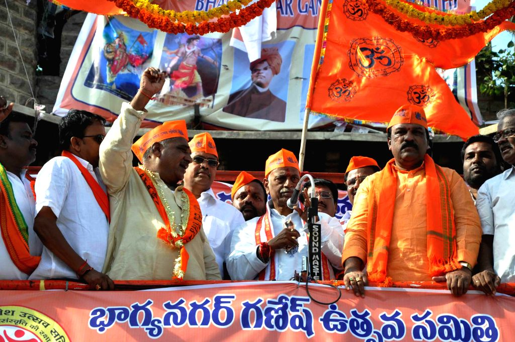 BJP leader Bandaru Dattatreya and others participate in a Ganesh idol immersion procession after Ganesh Festival in Hyderabad on Sept 8, 2014.