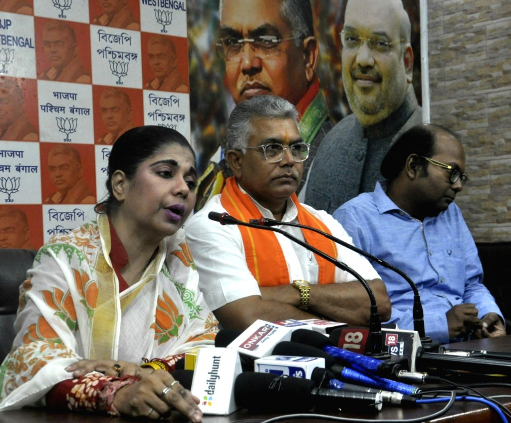 BJP leader Bharati Ghosh accompanied by West Bengal party President Dilip Ghosh, addresses at the state party headquarters in Kolkata on Oct 14, 2019. - Bharati Ghosh and Dilip Ghosh