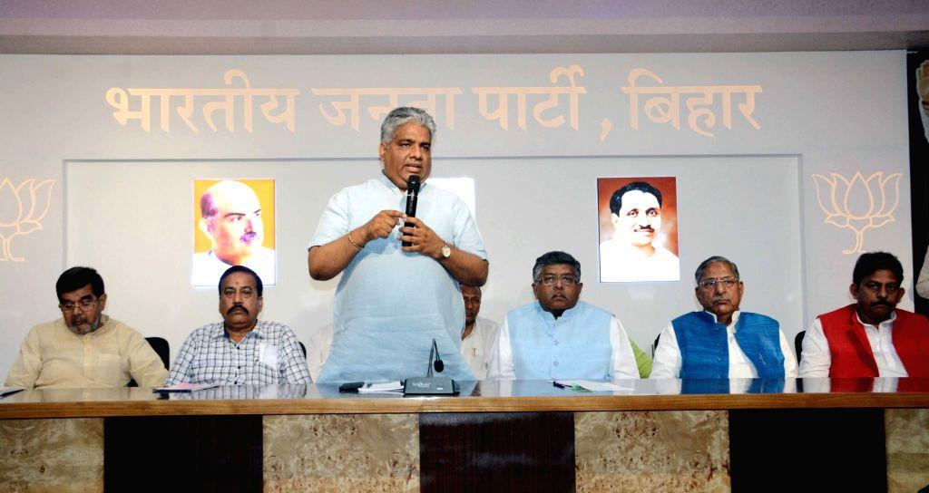 BJP leader Bhupender Yadav accompanied by Union Minister Ravi Shankar Prasad and Bihar Cabinet Minister Nand Kishore Yadav, addresses at a party meeting in Patna, on April 24, 2019. - Ravi Shankar Prasad, Bhupender Yadav and Nand Kishore Yadav