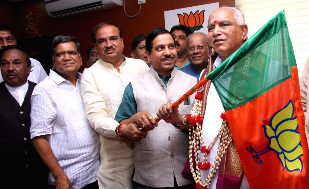 BJP leader BS Yedduyurappa takes charge as Karnataka BJP chief in Bengaluru on April 14, 2016. Also seen Union Minister Ananth Kumar, BJP leaders Jagadeesh Shettar and KS Eshwarappa. - Ananth Kumar