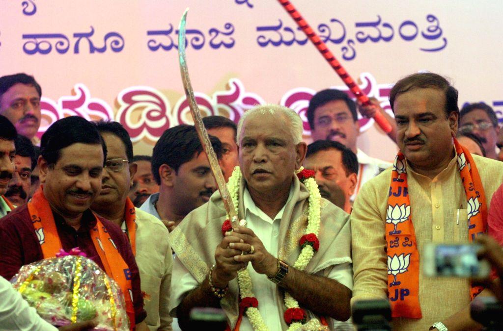 BJP leader BS Yedduyurappa takes charge as Karnataka BJP chief in Bengaluru on April 14, 2016. Also seen Union Minister Ananth Kumar, BJP leaders Jagadeesh Shettar and KS Eshwarappa. - Ananth Kumar
