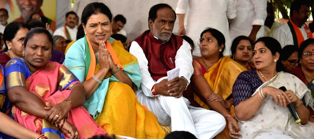 BJP leader D. K. Aruna with the Telangana party President K. Laxman, during her hunger strike demanding ban on liquor in the state, in Hyderabad on Dec 12, 2019.