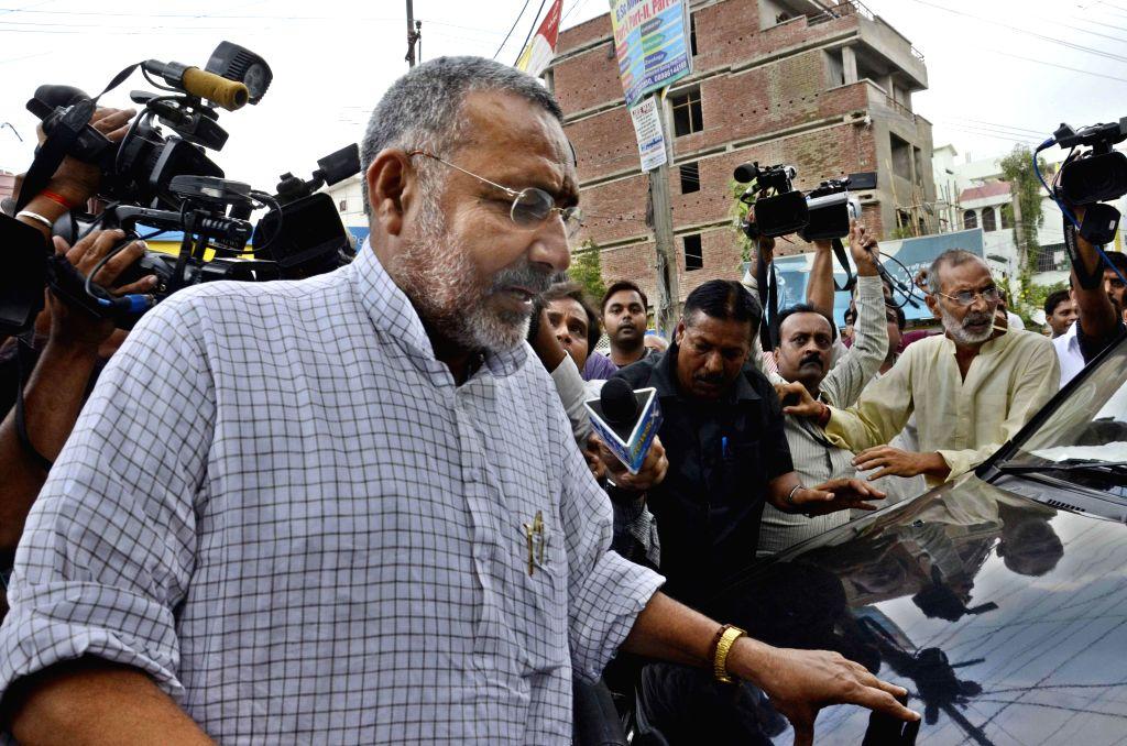 BJP leader Giriraj Singh arrives at S K Puri police station in Patna on July 12, 2014.
