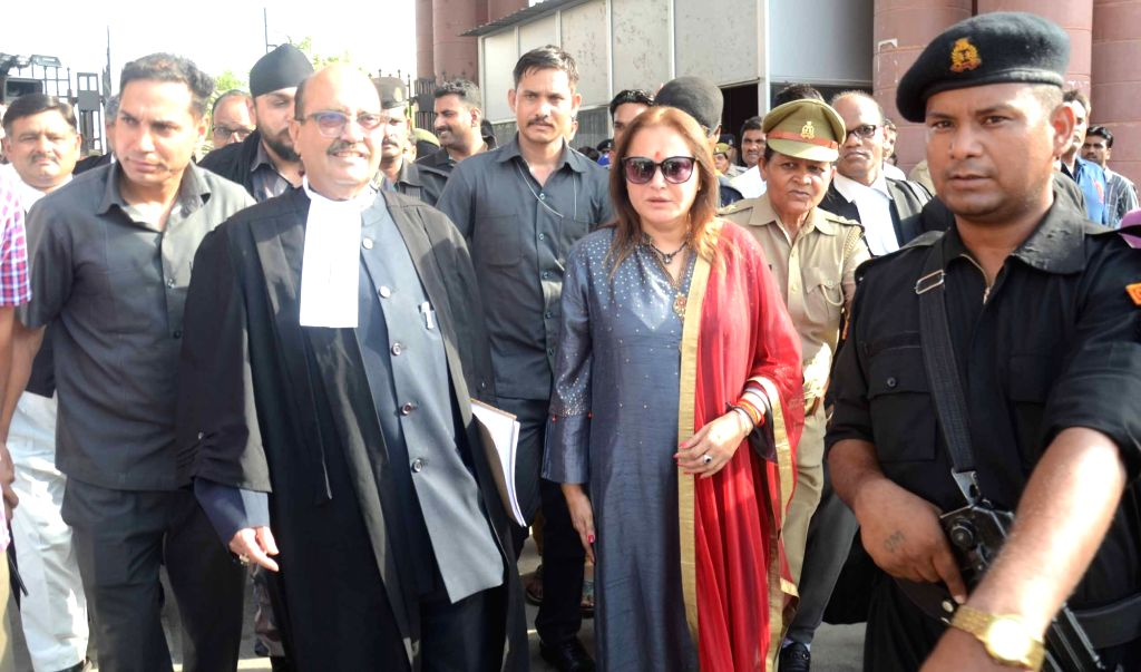 BJP leader Jaya Prada and her counsel and Former SP leader Amar Singh come out after the hearing of the former's petition seeking the disqualification of Samajwadi Party (SP) MP Mohd Azam ... - Amar Singh and Mohd Azam Khan