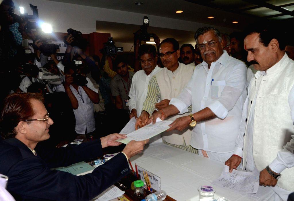BJP leader L Ganesan files his nomination papers for Rajya Sabha elections at Madhya Pradesh Assembly in Bhopal on Sept 30, 2016. Also seen Madhya Pradesh Chief Minister Shivraj Singh Chouhan. - Shivraj Singh Chouhan
