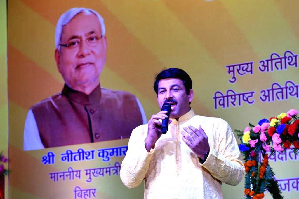 BJP leader Manoj Tiwari addresses during a programme, in Patna on July 30, 2018.