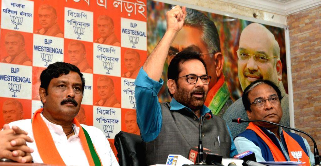 BJP leader Mukhtar Abbas Naqvi accompanied by party leader Jay Prakash Majumder, addresses a press conference, in Kolkata, on May 12, 2019.