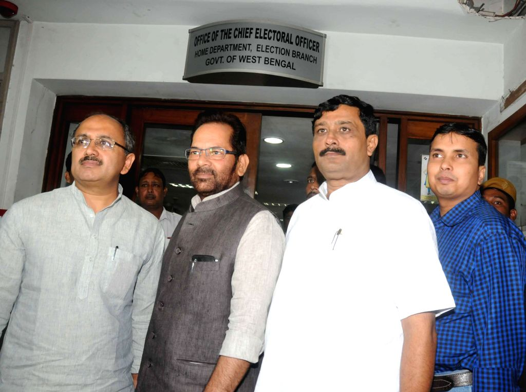 BJP leader Mukhtar Abbas Naqvi (C) with West Bengal BJP chief Rahul Sinha and party leader Siddhinath Singh at the office of West Bengal Chief Electoral Officer in Kolkata on Sept 8, 2014. - Rahul Sinha and Siddhinath Singh