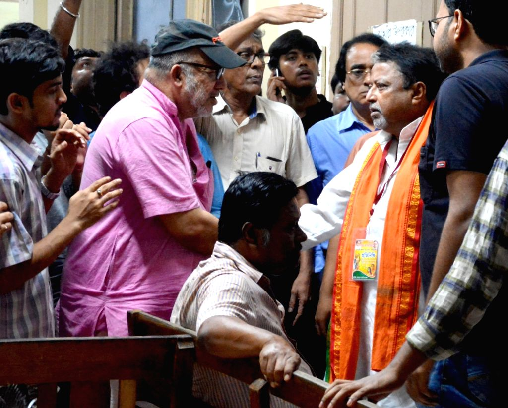BJP leader Mukul Roy and singer Kabir Suman interact with medical students sitting on a hunger strike during their visit to Medical College and Hospital, in Kolkata on July 22, 2018. - Mukul Roy