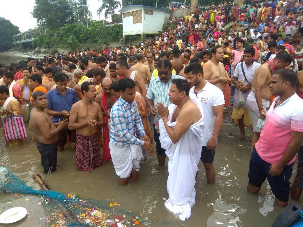 "BJP leader Mukul Roy performs 'Tarpan' on the last day of ""Pitru Paksha"" at Ganga river in Kolkata on Sep 28, 2019. - Mukul Roy"
