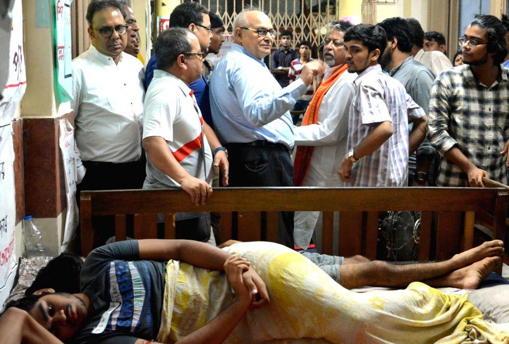BJP leader Mukul Roy visits medical students sitting on hunger strike at Medical College and Hospital, in Kolkata on July 22, 2018. - Mukul Roy