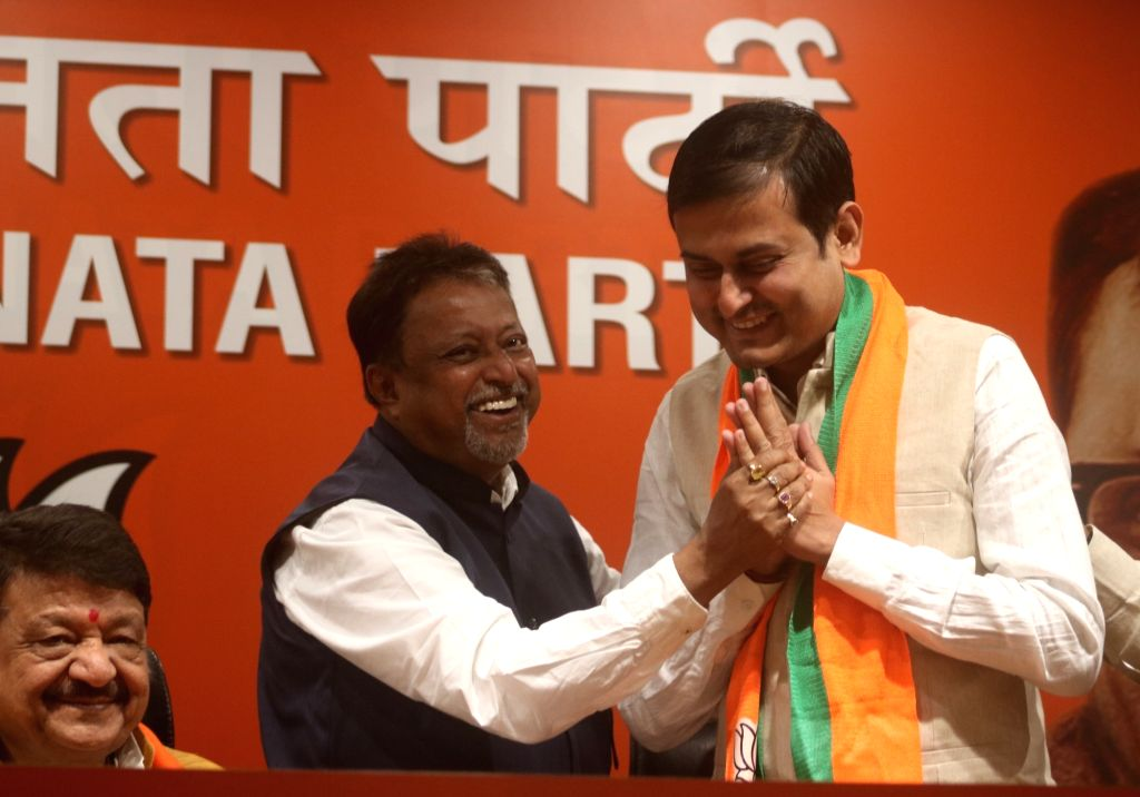 BJP leader Mukul Roy with Shankudeb Panda who joined the party in New Delhi on Feb 18, 2019. - Mukul Roy