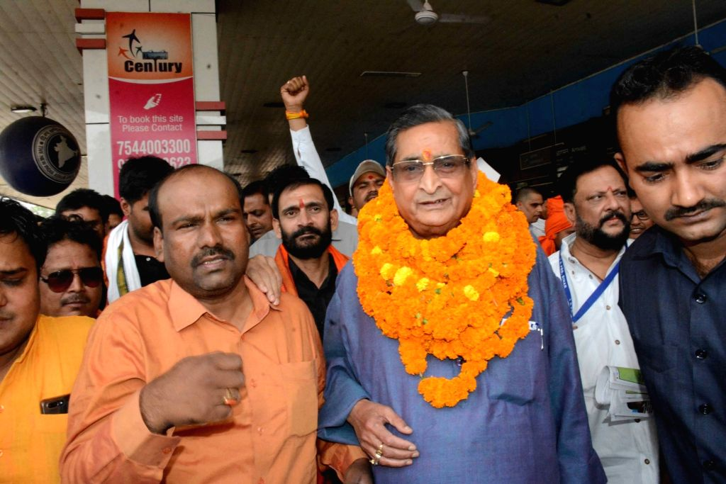 BJP leader R.K. Sinha being welcomed by party workers on his arrival at Jay Prakash Narayan International Airport in Patna, on May 11, 2019. - K. Sinha