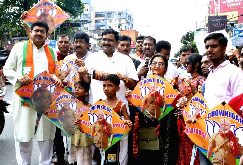 BJP leader Rahul Sinha distribute kites with the picture of Prime Minister Narendra Modi ahead of Biswakarma Puja in Kolkata on Sep 15, 2019. - Narendra Modi and Rahul Sinha