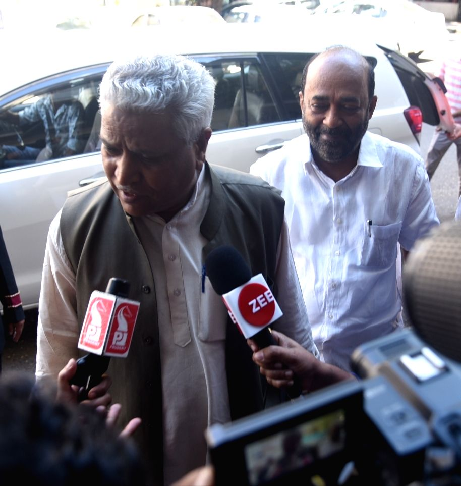 BJP leader Ram Lal talks to press as he arrives for a meeting with senior party leaders and coalition partners in Panaji on Sept 16, 2018. Also seen Goa BJP chief Vinay Tendulkar.