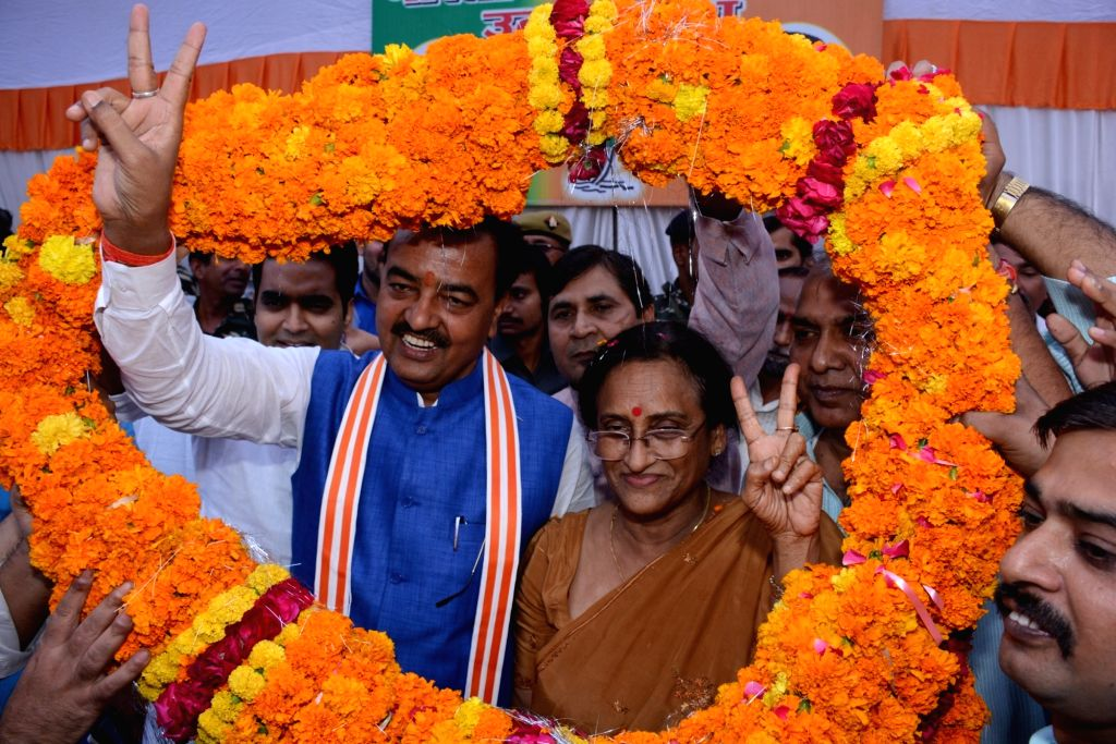 BJP leader Rita Bahuguna Joshi receives a grand welcome at the party office in Lucknow on Oct 26, 2016. Rita Bahuguna Joshi joined BJP in presence of party chief Amit Shah on Oct 20, 2016. - Rita Bahuguna Joshi and Amit Shah