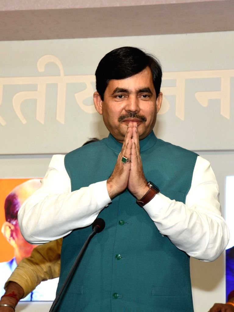 BJP leader Shahnawaz Hussain greets media personnel ahead of addressing a press conference in Patna on Nov 15, 2019.