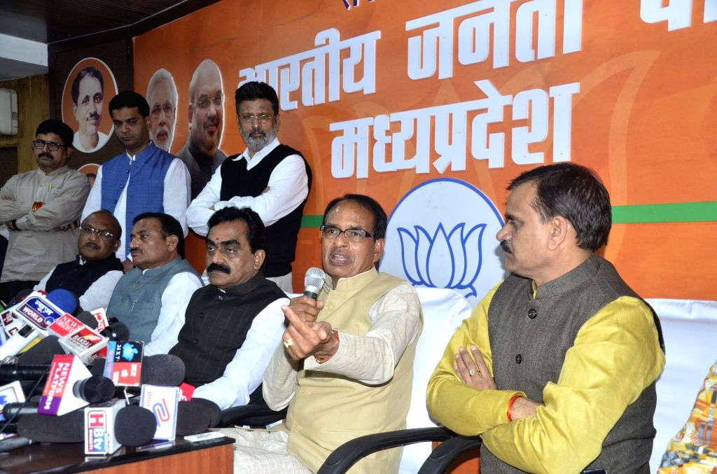 BJP leader Shivraj Singh Chouhan addresses a press conference in Bhopal on Dec 12, 2018. Also seen Madhya Pradesh BJP President Rakesh Singh. - Shivraj Singh Chouhan and Rakesh Singh