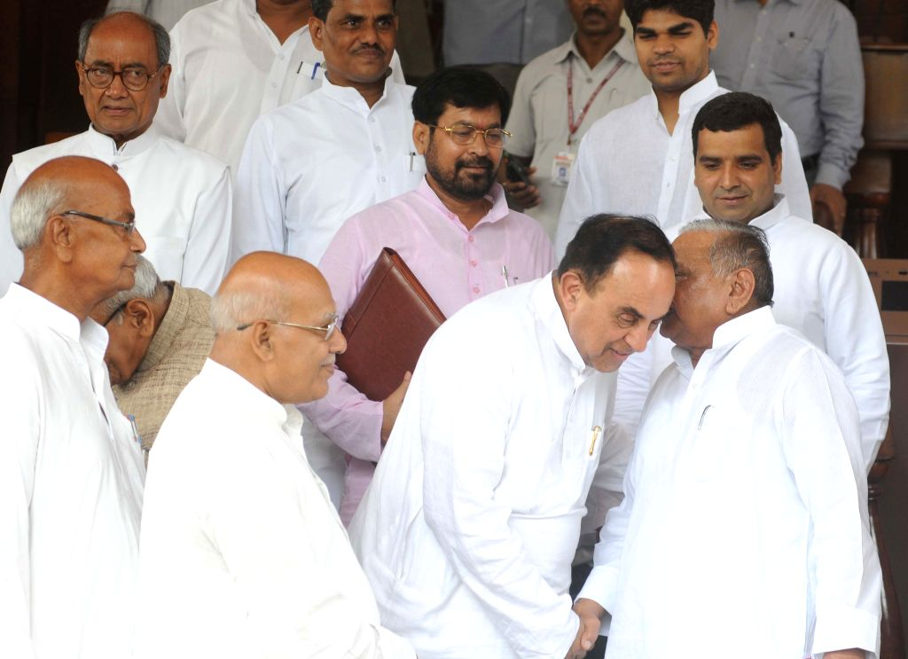 BJP leader Subramanian Swamy speaks to Samajwadi Party Chief Mulayam Singh Yadav at the Parliament in New Delhi, on Aug 12, 2015. Also seen  Digvijay Singh, Moti Lal Vohra and others.