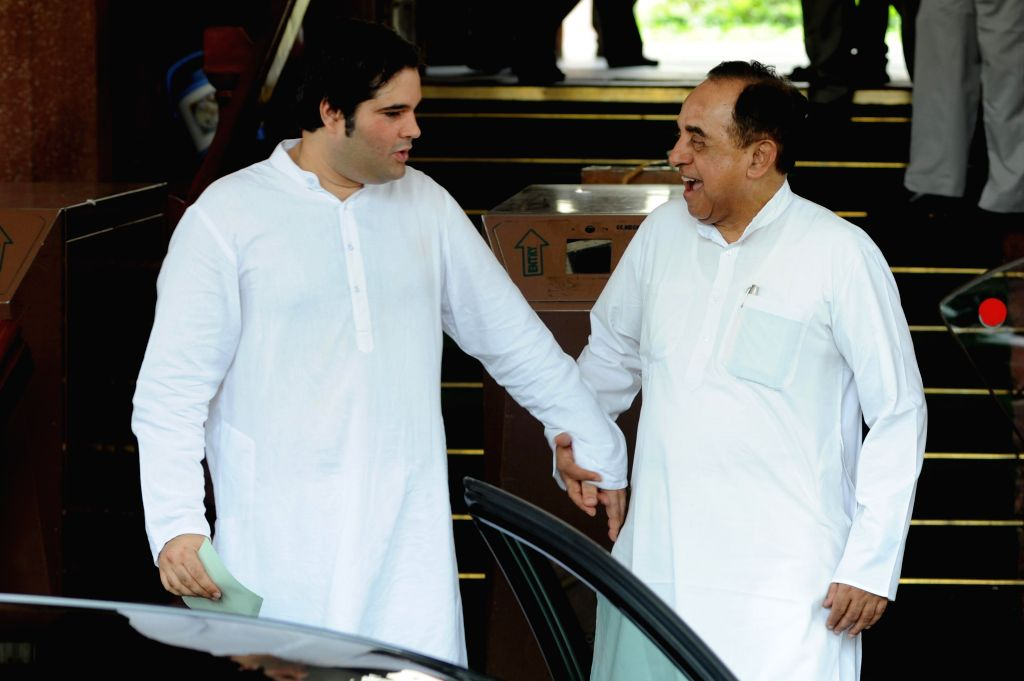 BJP leader Sultanpur MP Varun Gandhi with party leader Subramanian Swamy at the Parliament in New Delhi on July 15, 2014. - Varun Gandhi