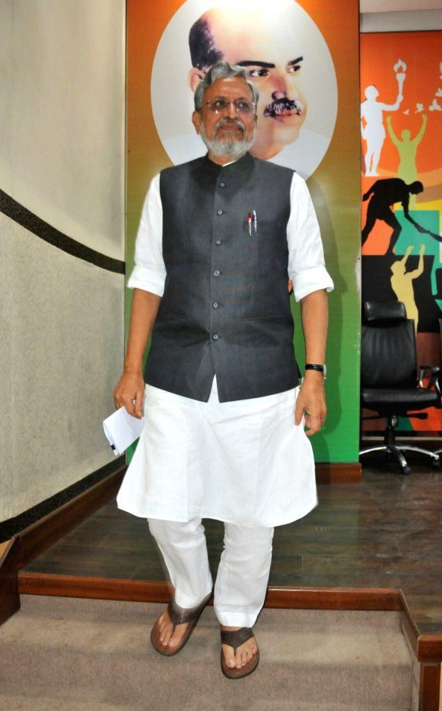 BJP leader Sushil Kumar Modi address a press a conference in New Delhi, on July 5, 2017. - Sushil Kumar Modi
