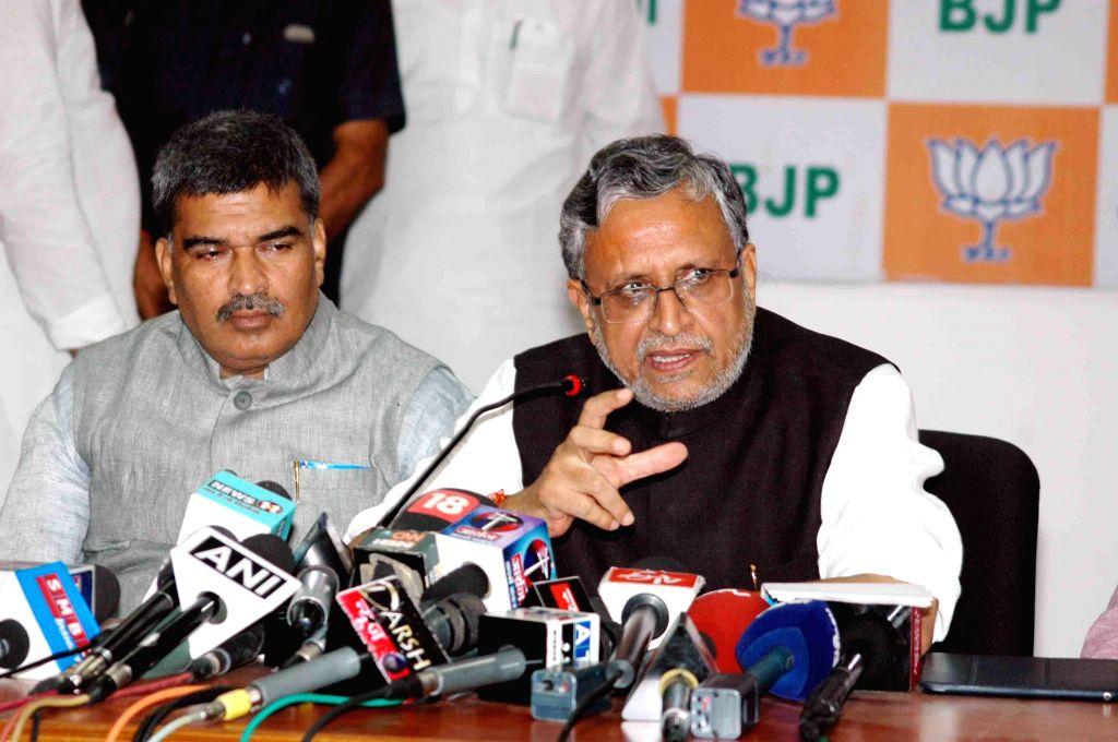 BJP leader Sushil Kumar Modi addresses a press conference in Patna on Aug 12, 2015. - Sushil Kumar Modi