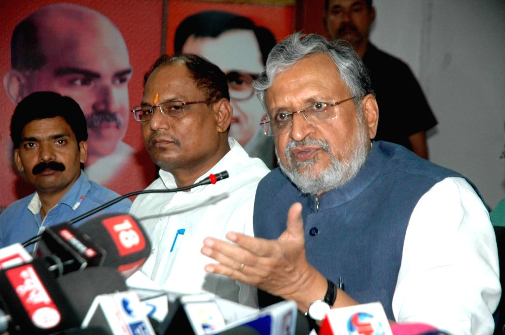 BJP leader Sushil Kumar Modi addresses a press conference in Patna, on June 10, 2017. - Sushil Kumar Modi